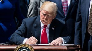 Abuse Of Power: Donald Trump Just Signed An Executive Order Stating That He Is Allowed To Get Inside John McCain's Coffin With Him
